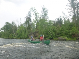 Paddling down 2nd rapids at Homeplace